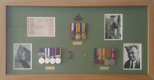 Family medal collection framed with badges