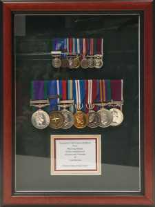 Full size and minture medal in a traditional frame