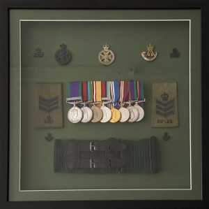 Medals in a frame with a stable belt, badges and rank sldies