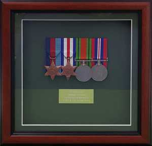Old set of medals in a traditional frame