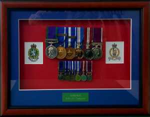 Full size and minitures framed with 2 printed corp badges