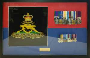 Two sets of medals framed with a hand embroidered Royal Artillery badge